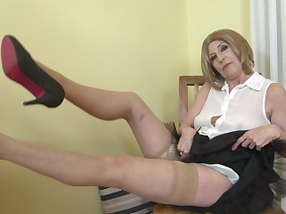 Short haired mature blonde amateur Danny strips and fingers herself