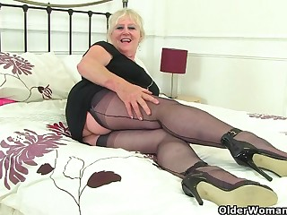 British gilf Zadi fucks the brush elderly fanny with a black dildo